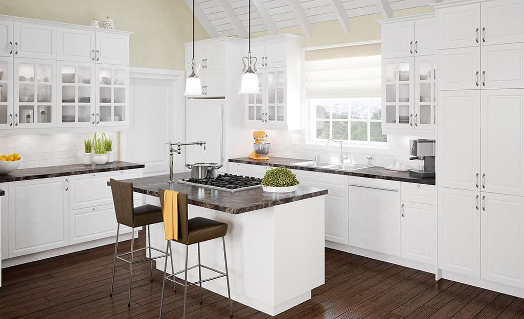 White kitchen cabinets in a corner-style layout.