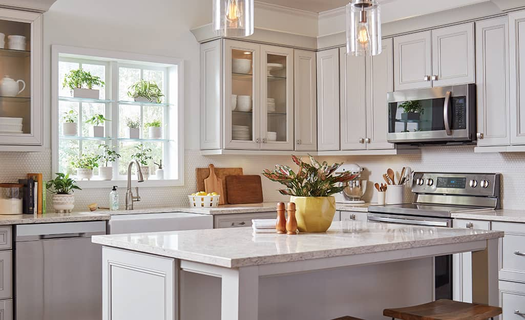Kitchen cabinets painted in neutral color tones.