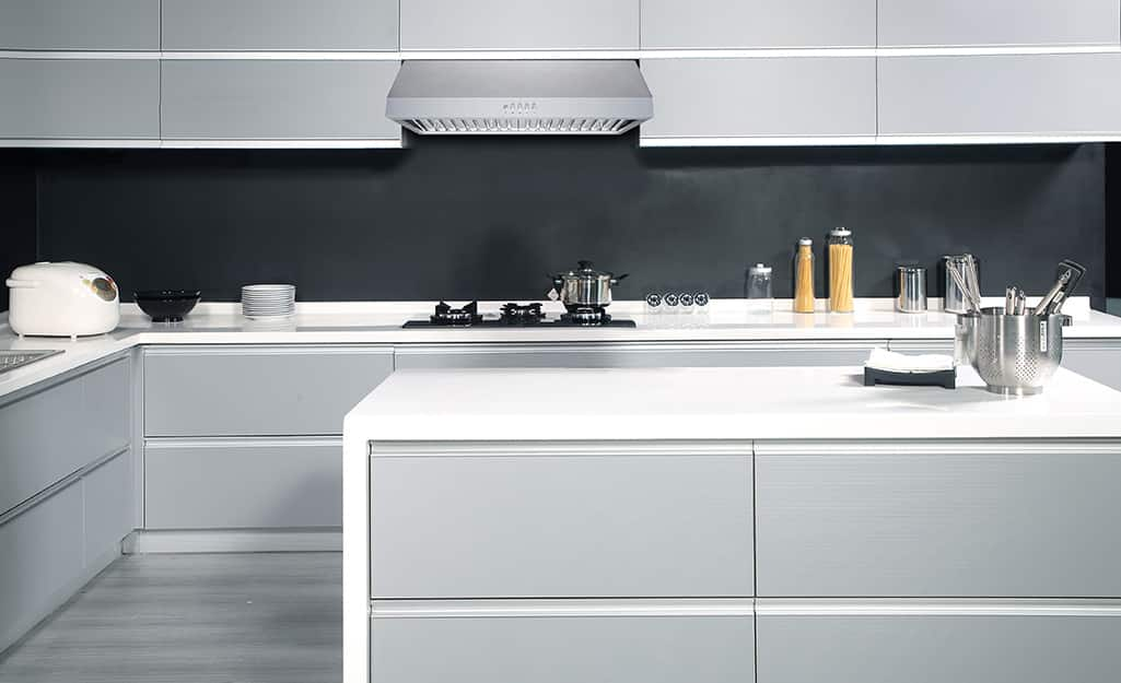 Kitchen cabinets with recessed handles.