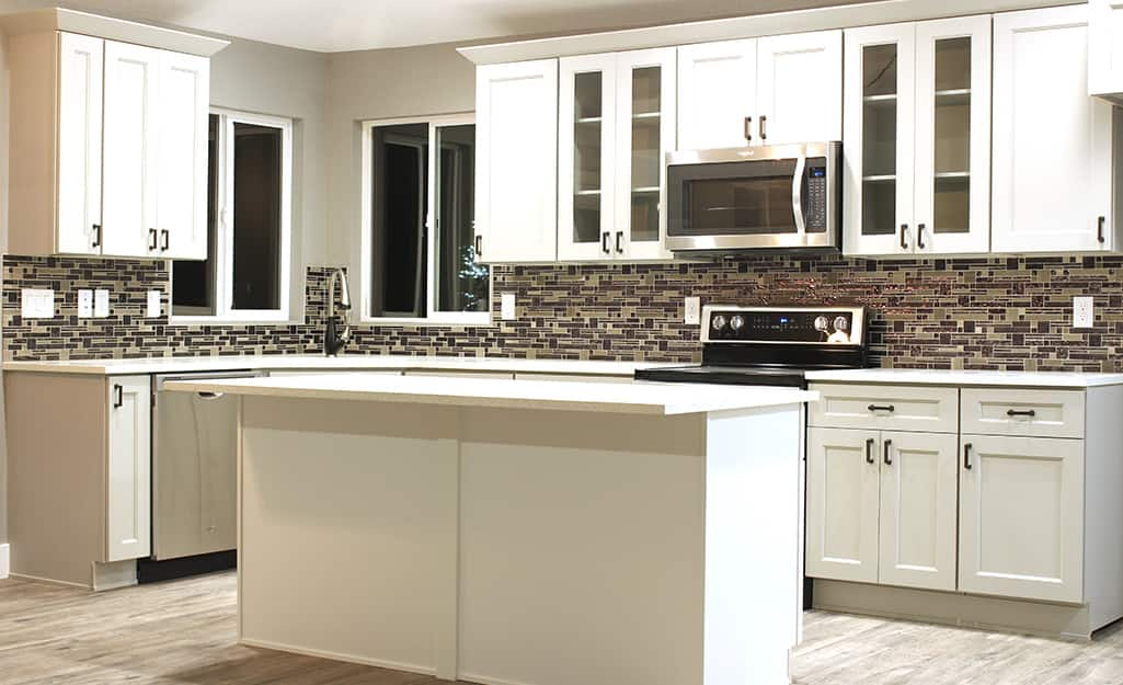 A kitchen installed with modular cabinets.