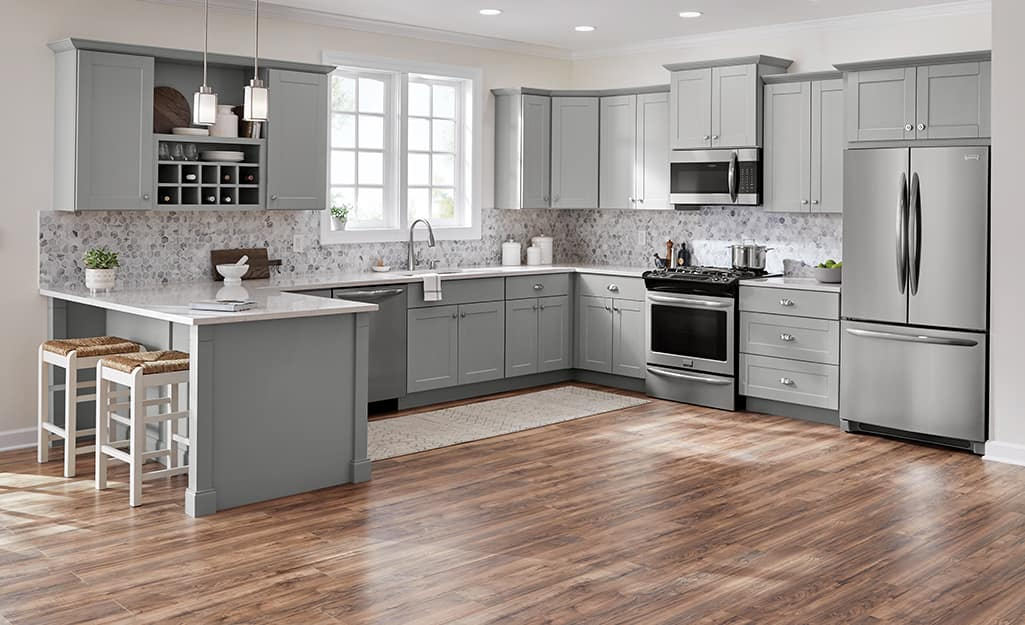 Open shelves built between kitchen cabinet cupboards.