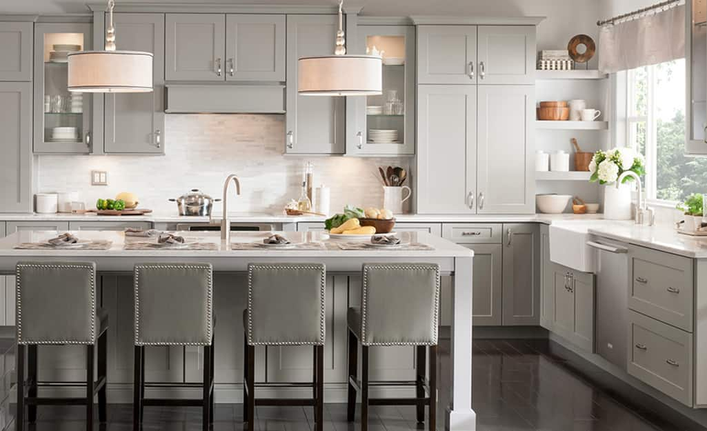An L-shaped kitchen layout with high cabinets.