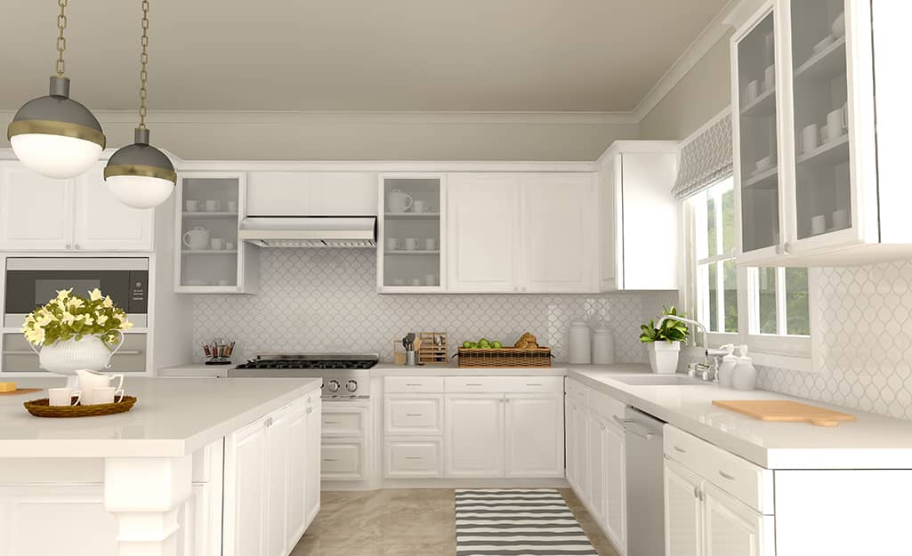Glass-fronted cabinets in a white kitchen.