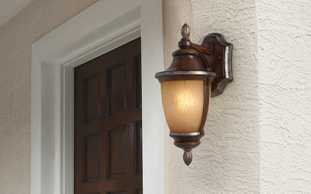 An outdoor wall light on an exterior wall of a house.