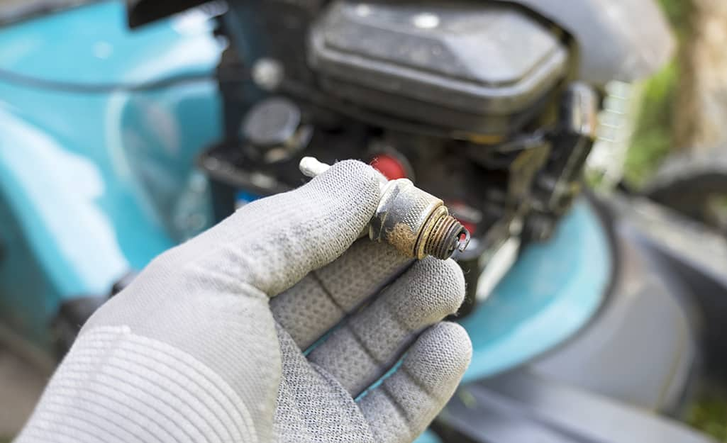 Someone changing a spark plug.