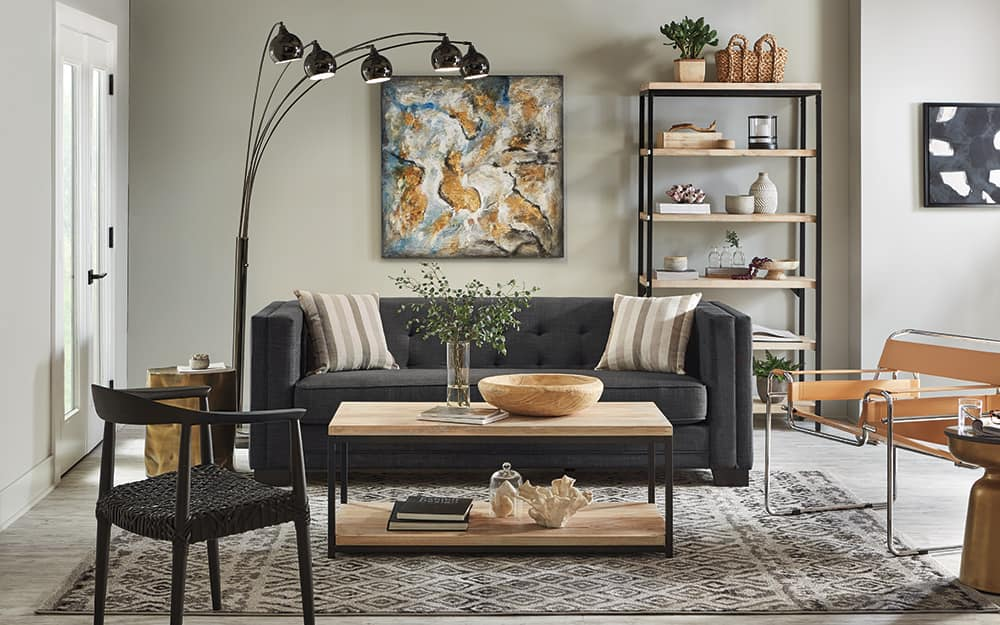 A living room with modern decor and floor lamp.