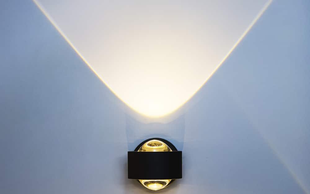 A light beam on a wall from a light bulb