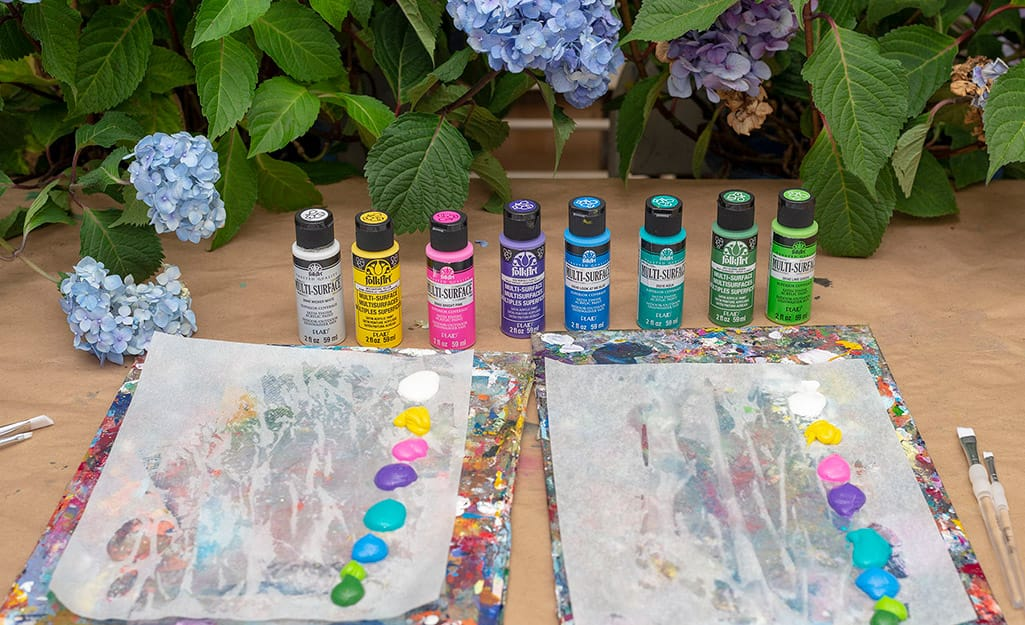 A collection of acrylic paint on a table.