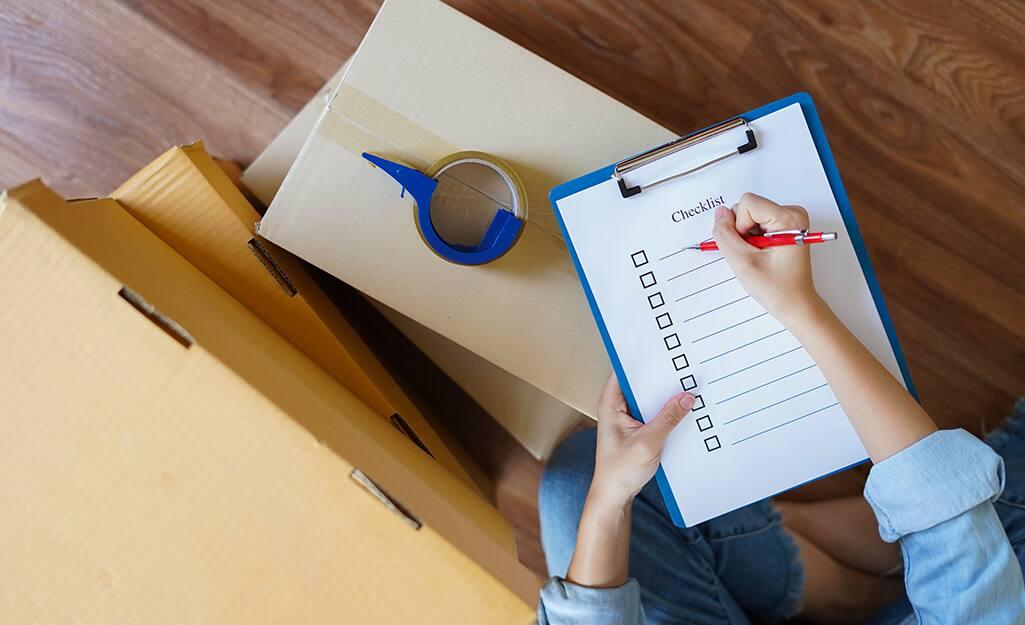 A woman makes a moving checklist.