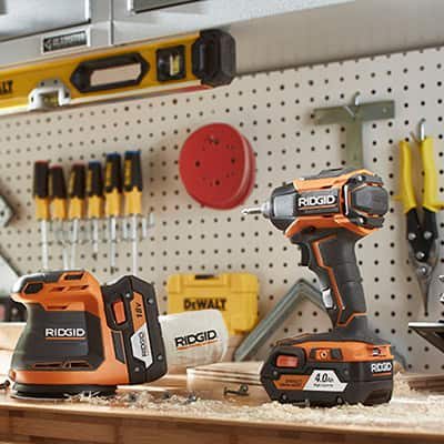 Various power tools sit on a workbench.