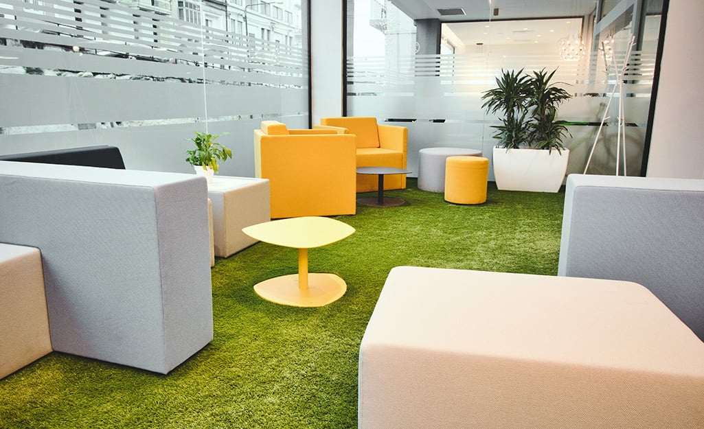 Cheery bright yellow and beige seating placed in an open office setting.