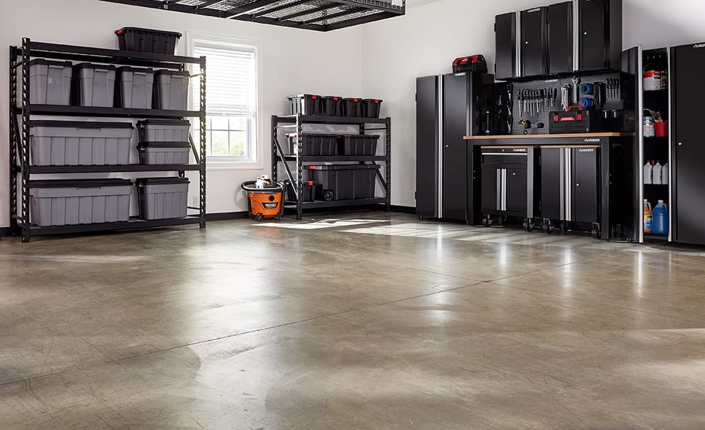 A garage workspace that features a concrete floor colored with concrete stain.
