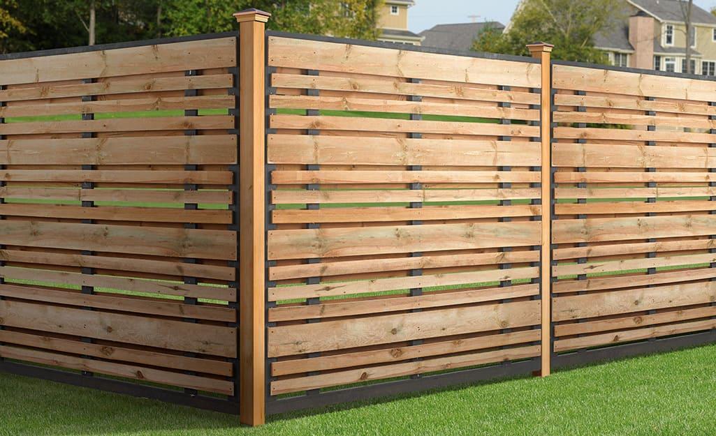 A natural wood-toned horizontal slat fence.