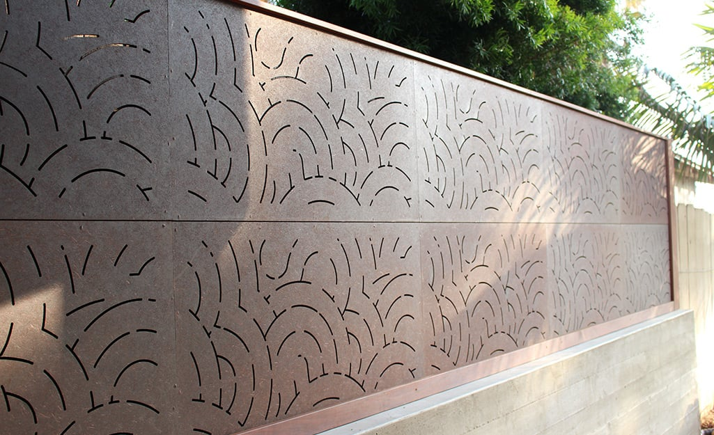 Composite privacy fencing surrounds a home.