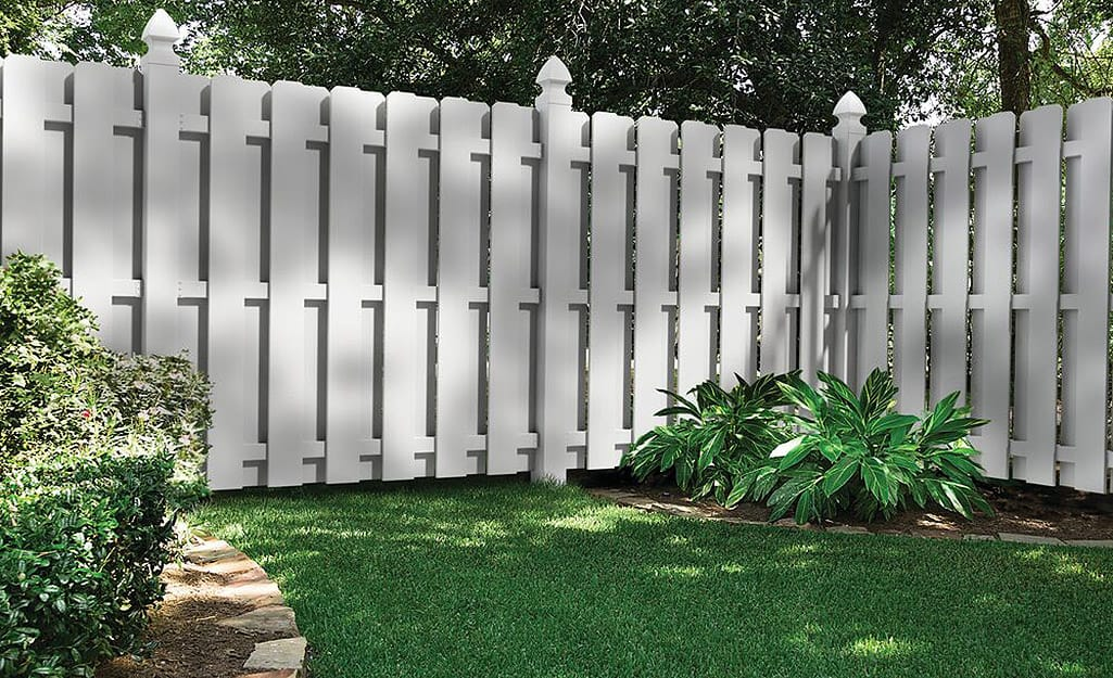 A shadow box privacy fence blocks the view of a yard