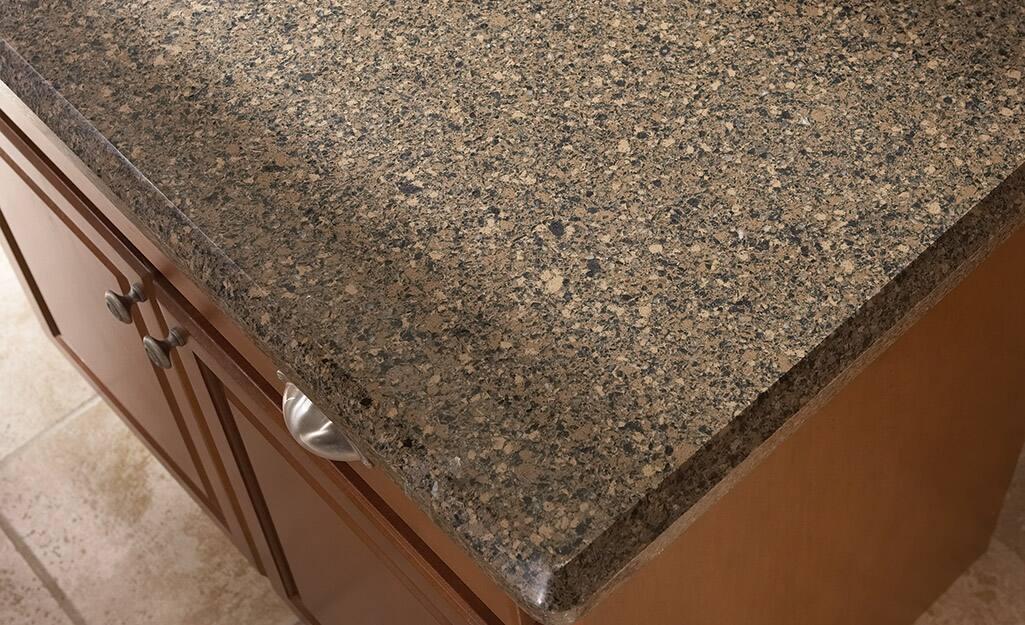 Brown speckled quartz countertop.