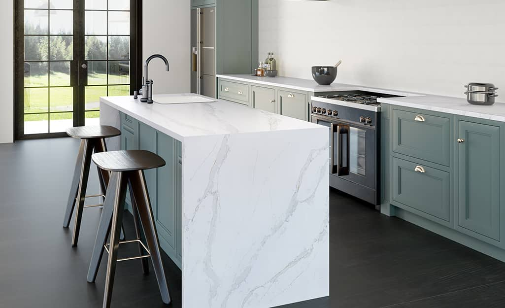 Waterfall kitchen island with white marbled quartz countertops.