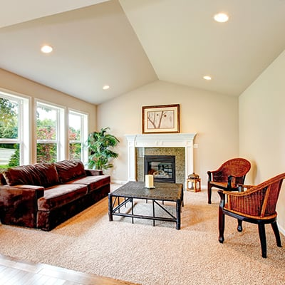 a living room featuring recessed lighting on a sloped ceiling