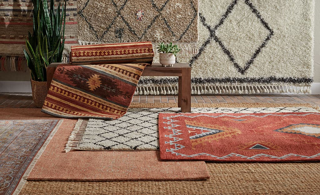 Rectangular rugs hanging on the wall.