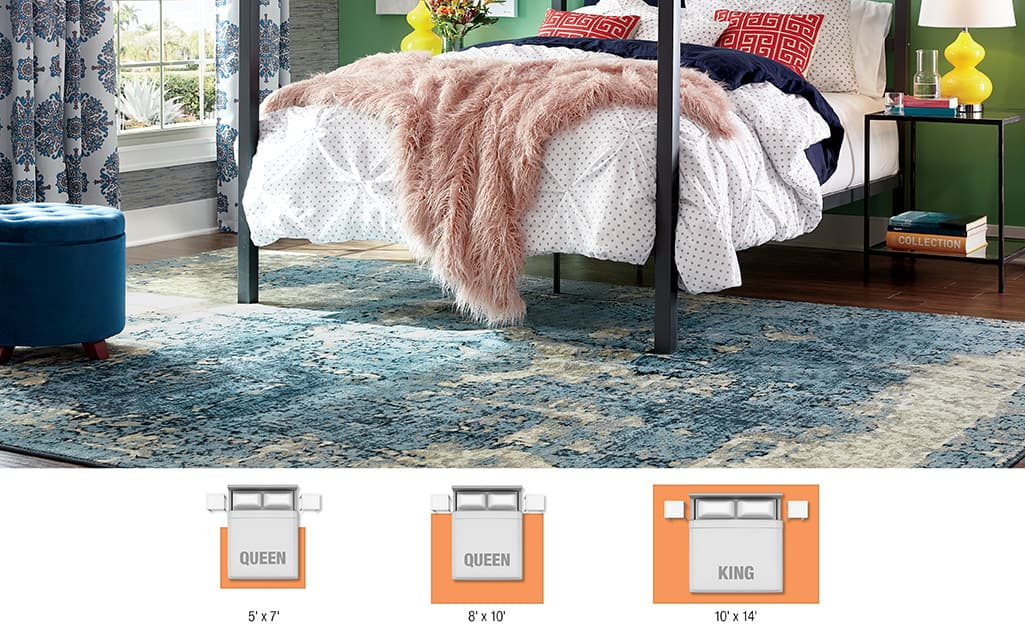 A poster bed resting on a bedroom area rug.