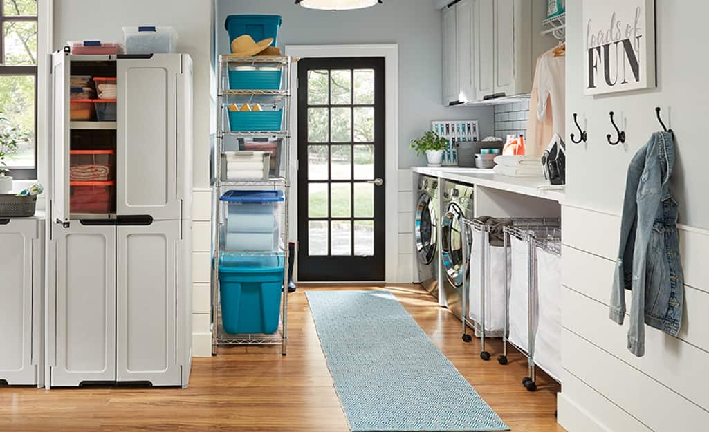 A laundry room featuring a blue runner.