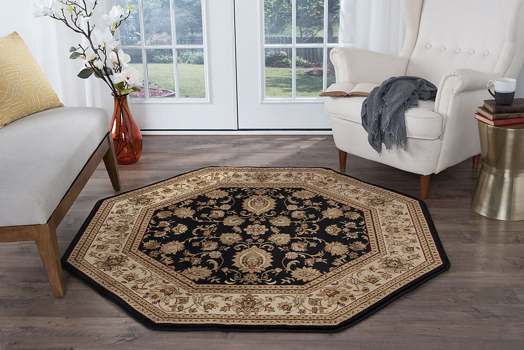 A seating area creates with an octagon-shaped rug.