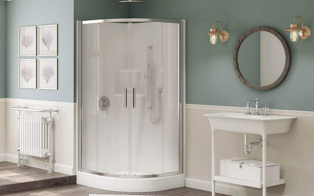A bathroom with a corner shower that has round shower doors.