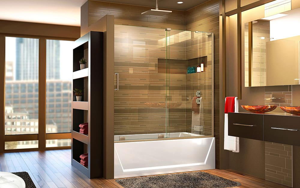 A bathroom with a shower tub combo that has glass sliding shower doors.