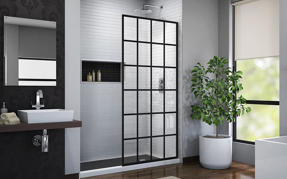 A barrier-free shower with a fixed shower door panel.
