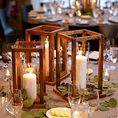 A table decorated with DIY wooden lanterns.