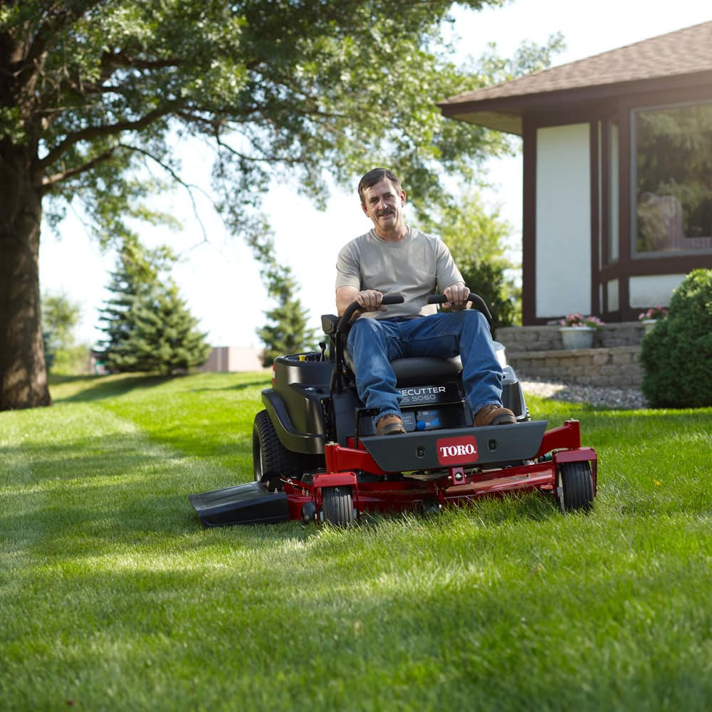 Homeowner mowing yard