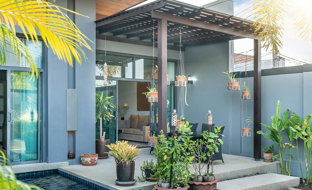 A small patio covered by a pergola.