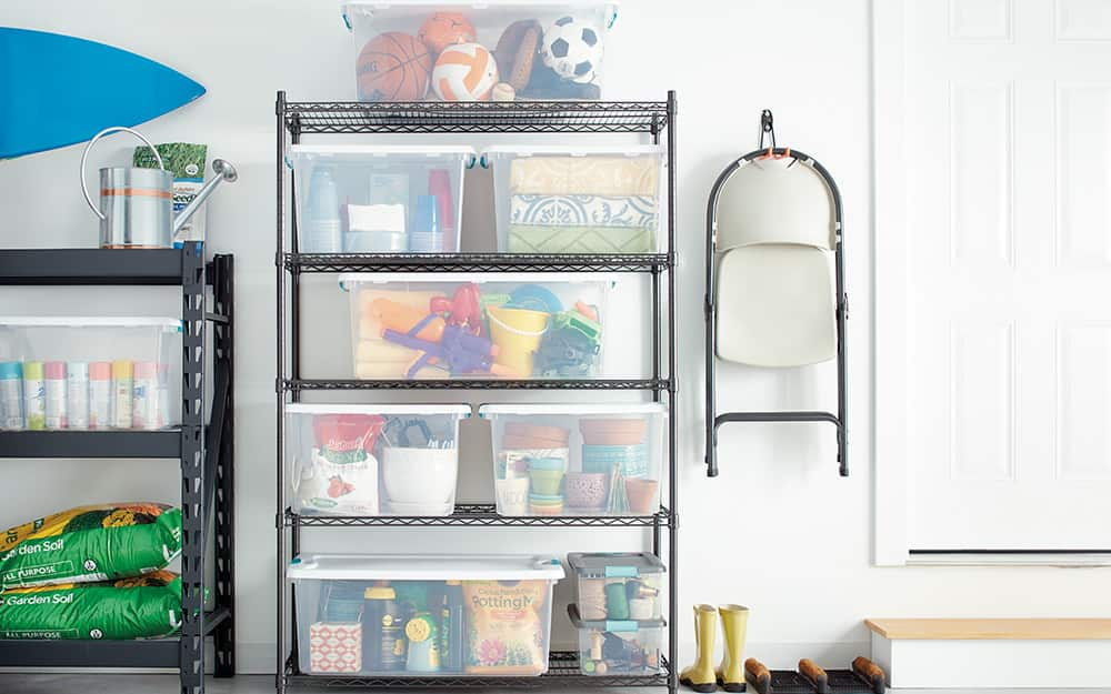 Stack of clear storage bins filled with various items.