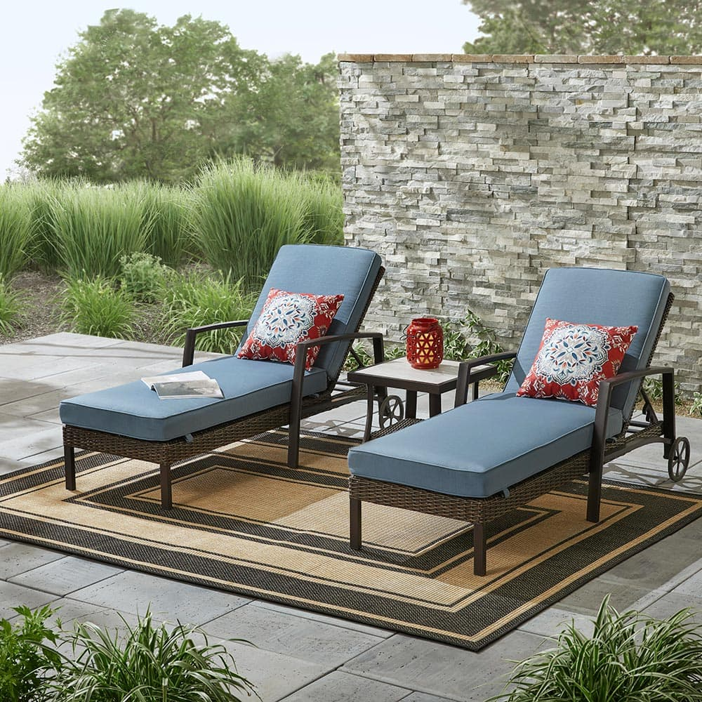 A pair of lounge chairs on a patio deck.