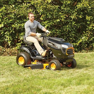Man using a riding lawn mower to cut his grass
