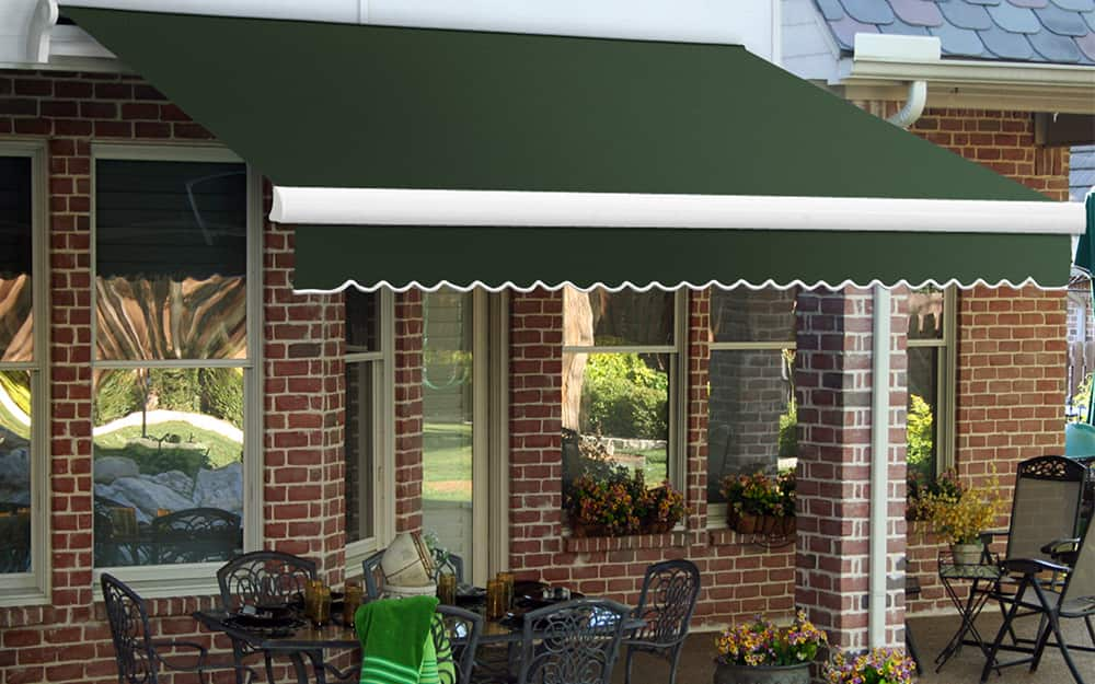 a retractable awning on the side of a brick building