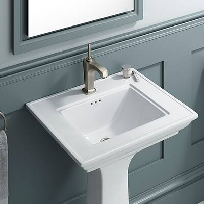 A simulated marble vanity top with a white undermount sink.