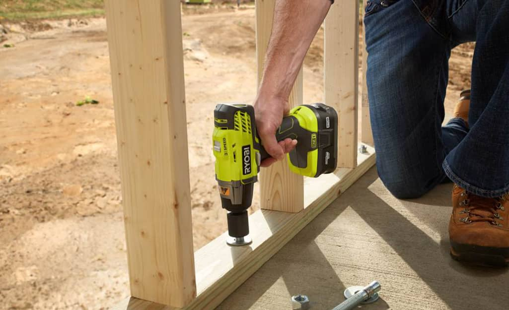 A worker uses a drill powered by a lithium-ion battery.