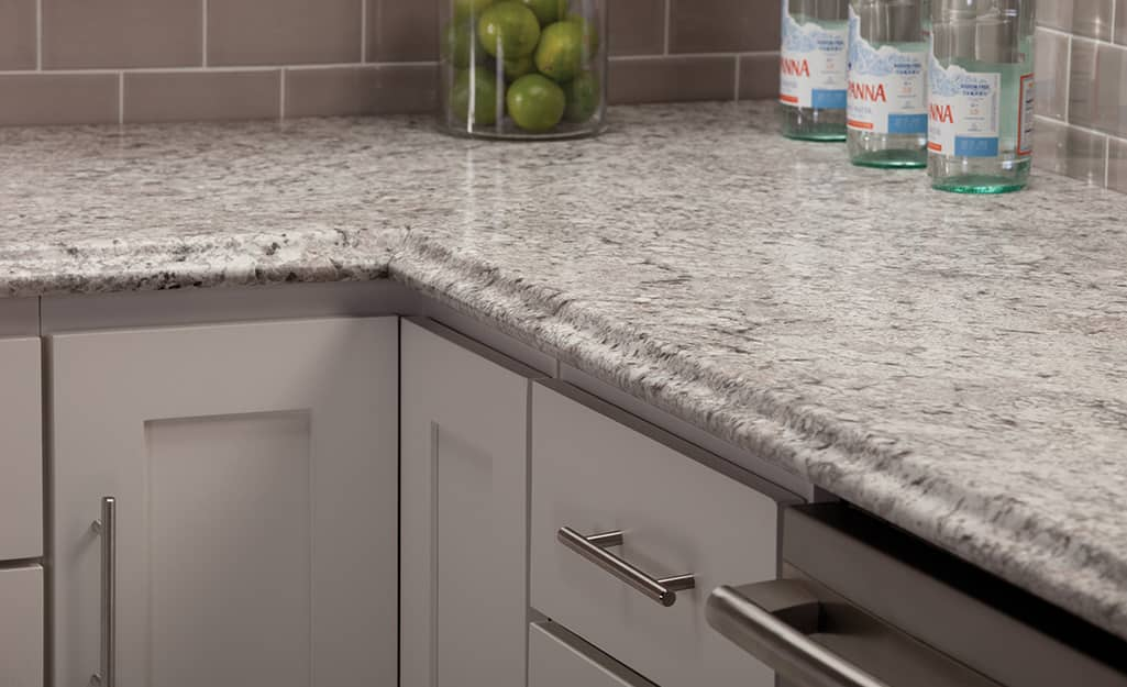 Granite countertop with ogee countertop edges.
