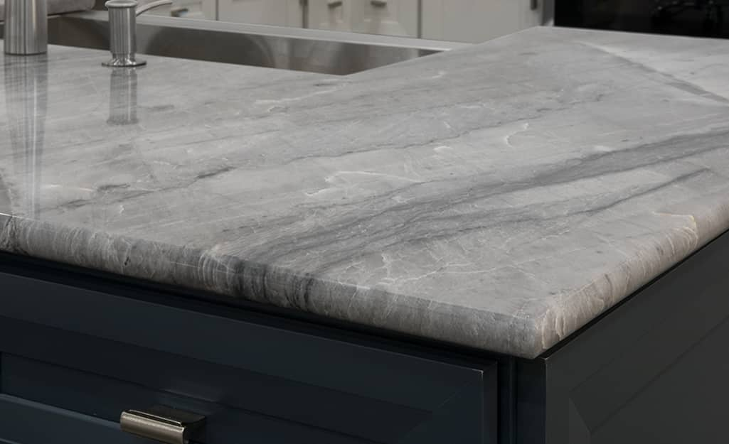 A gray granite countertop with bullnose edges.