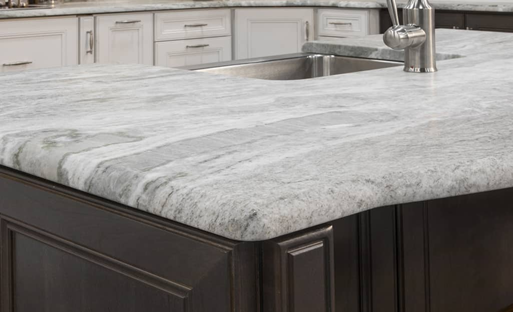 A natural stone countertop with half bullnose edges.