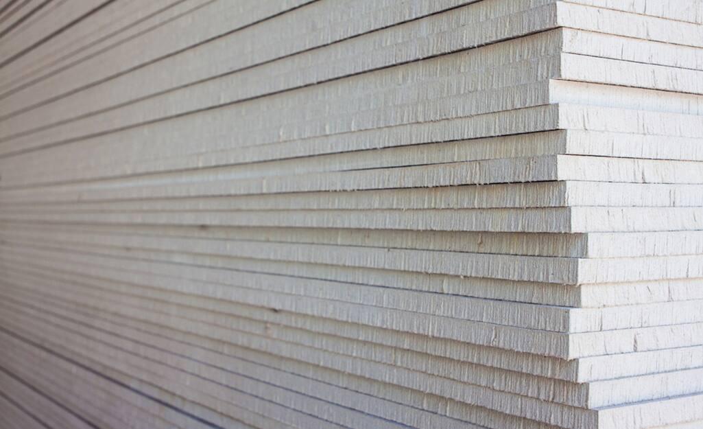 Stacks of drywall sheets.