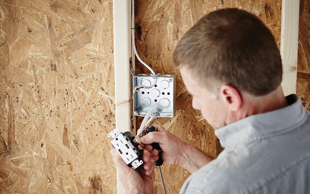 Man installing an electrical box.
