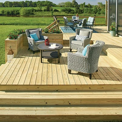 A furnished deck with a natural wood finish.