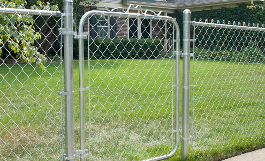 A chain link fence with a gate.