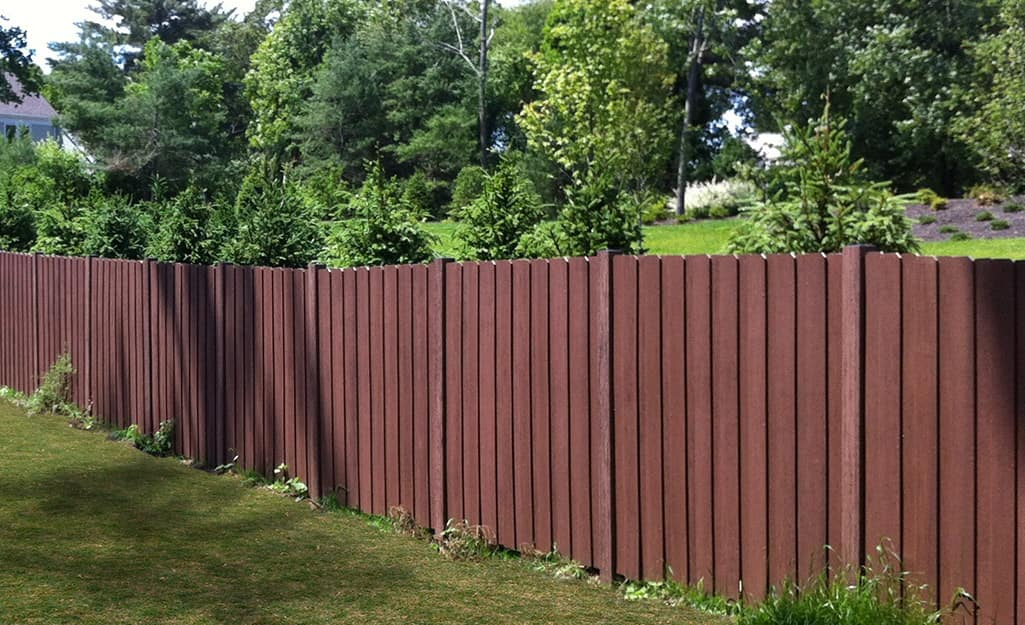 A composite fence designed to resemble wood.