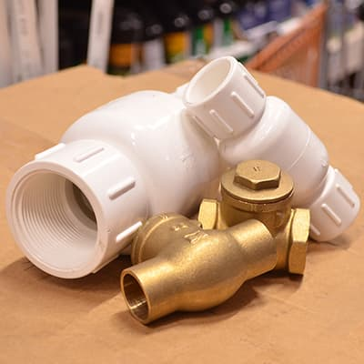 Several types of pipe fittings are displayed on a table.