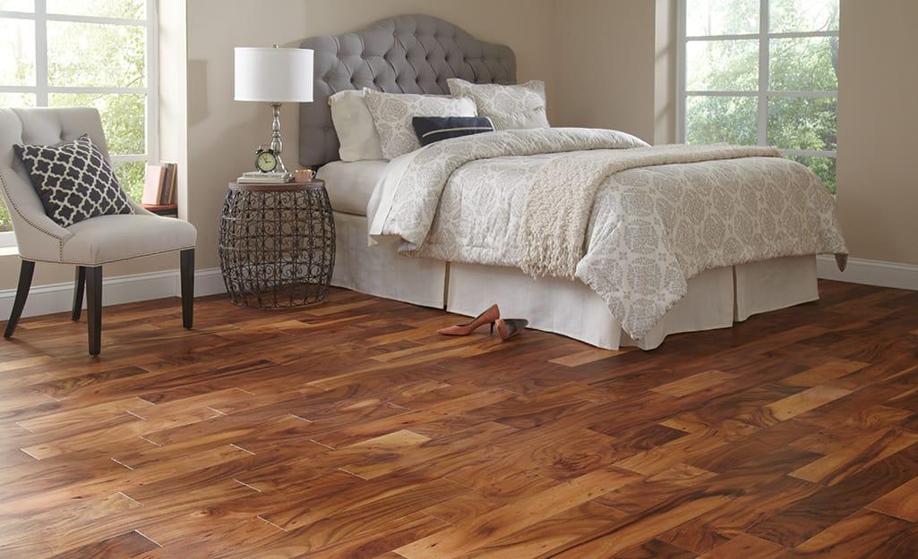 A bedroom with hardwood flooring.