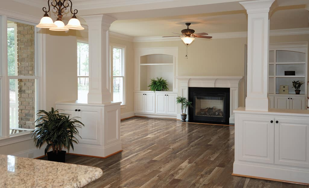 Laminate flooring in a living room and hallway area.