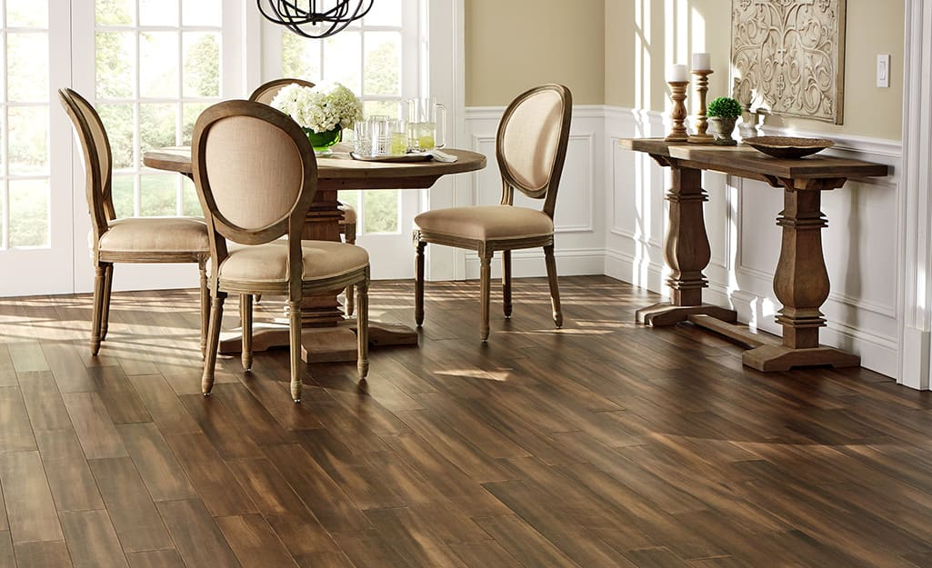 A dining room with bamboo flooring installed.